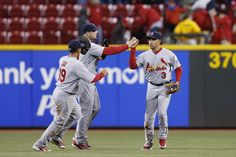 Jay, Holliday and Beltran celebrate after beating the Reds.  4-9-12