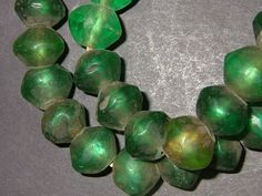Very Old African Trade green Vaseline beads made in the mid 1800's in Bohemia . 24 in. 14 x 16 mm. (ATN52)