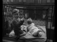 The Baby Cage. It looks quite alarming but presumably it was pretty safe. A flat with no terrace or garden didn't deter this woman. Instead she built a cage for her baby -  the cage hung outside the window. A self built balcony really!     Browse 90,000 archive reels for free on http://www.britishpathe.com and join the British Pathe archive on Fac...