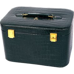 Hermes Crocodile Train Case  France    This luxurious Hermes black crocodile train case dates to the mid 1950's and it is from the estate of a titled French woman. Her gold coronet and initials are on the top of this lovely bag.