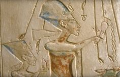 Relief of Akhenaten and Nefertiti under the rays of the sun-god Aten clutching ankhs Egyptian Museum, Cairo