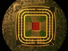 Photograph of the amplifier chip, attached to a circuit board with thin gold wirebonds.  Credit: Columbia Engineering