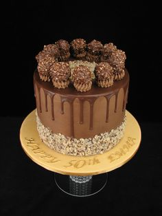 This Ferrero Rocher cake is made up of chocolate mudcake filled and covered in a hazelnut chocolate buttercream with chocolate drip. www.facebook.com/cakesbyleannerhodes White Chocolate Mud Cake, Chocolate Ganache Frosting, Chocolate Drip, Fondant Cake Toppers, Fondant Cakes, Cupcake Icing, Cupcake Cakes, Ferro Rocher Cake, Baby Cake Pops