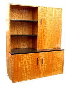 Satijnhouten Haagse School boekenkast met twee deuren onder een deur boven en zwart gebeitste boekenplanken met verchroomde grepen en onderrand ontwerp uitvoering Bas van Pelt / Den Haag ca.1935