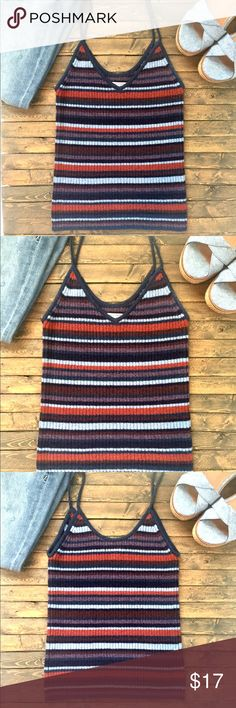 """💥SALE💥AEO Sweater Tank. NWOT. AEO striped stretch sweater tank in excellent unused condition. Perfect addition to your fall wardrobe and pairs wonderfully with your favorite jeans. Wear alone or layered. Colors are a mix of navy, blues, orange and purples. No snags or damages whatsoever. Material tag is last photo. Chest measures 12"""" across and overall length is 21.5"""". Home is smoke and pet free 🌺 American Eagle Outfitters Tops Tank Tops"""