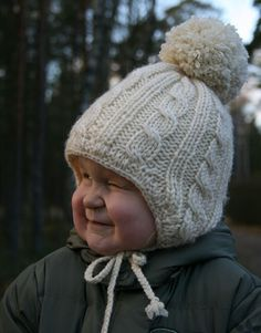 cabled ear flap hat free knitting pattern..don't you love the expression on that little face? lol