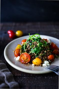 Lentils with Blistered Tomatoes and Kale- a simple vegetarian lentil recipe seasoned with Middle Eastern spices & topped with feta.