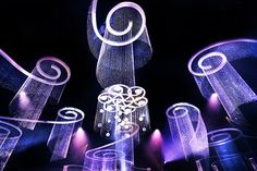 The Governors Ball included 30 chandeliers in all. The fixtures done in swirling shapes included Swarovski crystals supported with extra beads from Shop Wild Things. The intricate creations dropped a dramatic 27 feet to the tables. Photo: Nadine Froger Photography
