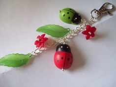Spring bagcharm, with ladybirds, leaves and flowers.  £6.00