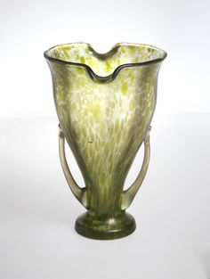"Vase, 1956-42-79, ca. 1910 | Collection of Smithsonian Cooper-Hewitt, National Design Museum. 6-5/16"" x 4-1/2"". Mottled green footed glass with two handles."