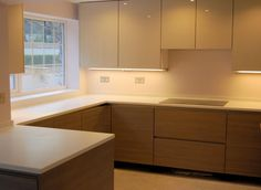 SieMatic kitchen installation in Ttan Pine and Sterling Grey high gloss