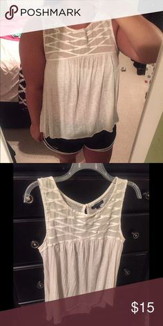 American Eagle Tank Beautiful off white American Eagle tank top! Very light weight so it is perfect for the summer time. Pretty crisscross detailing on the front and a small key hole on the back. Only worn a few times, in great condition! American Eagle Outfitters Tops Tank Tops