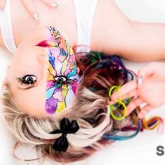 Colourful hair & face paint