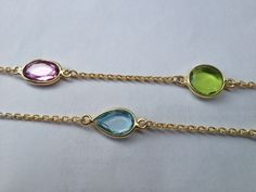 Multi gem set long chain in peridot and blue topaz.. great with a kaftan!