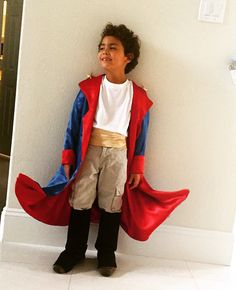 Costume, le petit prince/ jacket handmade in satin, belt too, and the boots were made out of felt, I put some wire in the hem so it make the form like the real little prince.