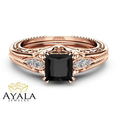 Make a lasting impression with this square Diamondengagement ring from Ayala Jewelry. Meticulously handcrafted and forged in designer detail, it is a fascinating filigree engagement ring for women of all ages. The band is made from solid 14K Rose Gold. A large Princess Natural Black Diamondadorns the top as a trellis of Natural Diamondscascade downwards from either side. It is an heirloom quality engagement ring that is sure to become a precious family heirloom. This is a limited edition…