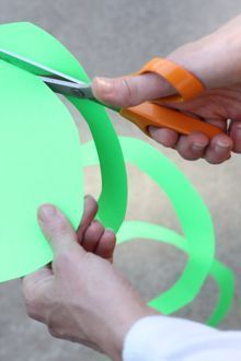 Spiral Streamers – DIY Party Decor: Take a sheet of heavyweight construction paper or card stock (8.5 by 11 inches is fine) and use scissors to round off the corners. Then start cutting the spiral. Begin from the outside edge and start cutting a strip about one inch wide. Work your way around making a long continuous spiral until you reach the center.
