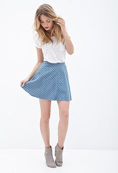 Take a slice out of Summer with this breezy skater skirt! Cut from a lightweight denim fabric with an allover petite polka dot print, you'll be flirting into warm weather days with ease! Finished with mock front welt pockets for charming finesse; pair it with a racerback tank and skip into town.