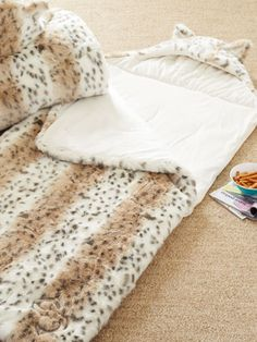 This faux-fur sleeping bag from PB teen is definitely a splurge, but it's totally a must-have if you love having slumber parties with your friends. Put it on your holiday wish list! ($179, pbteen.com)  Music and Movie Gifts - Holiday Entertainment Gifts - Seventeen #17holiday