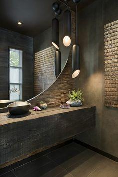 waschtisch aus holz rustikal holzbalken stein wand rund spiegel pendelleuchte modern