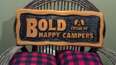 custom carved cedar camp sign by Adirondack Jim. 12 by 30. sikkens log finish
