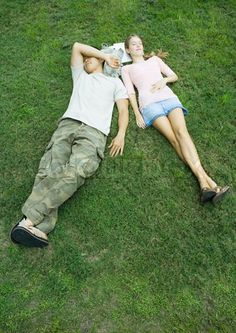 """Buy the royalty-free Stock image """"Young woman resting on grass overhead view"""" online ✓ All image rights included ✓ High resolution picture for print, we. Teen Couples, Young Couples, Stock Pictures, Stock Photos, Wonder Boys, Ya Novels, Psychedelic Rock, Christmas Couple, High Resolution Picture"""