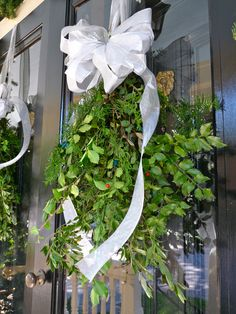 Find easy instructions for creating swags of cut greenery -- perfect alternative to your standard #wreath #diy #holiday | From The Home Depot's Apron blog Holiday Style Challenge series and Carrie of Hazardous Design