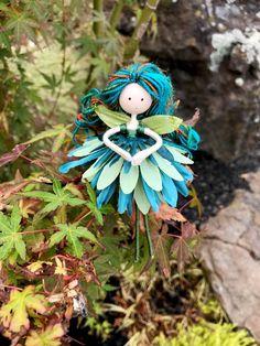 Fairy Doll. Blue Green Flower Fairy. Handmade Waldorf Doll. Garden Fairy Toy. Fairies. Fairy Doll Party Favor. Miniature Doll. Nursery Decor by WandsAndWillows on Etsy https://www.etsy.com/listing/555990951/fairy-doll-blue-green-flower-fairy