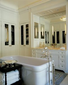Design Chic - love the mirrored doors in the bathroom