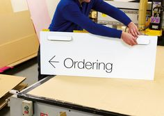 Each sign in the wayfinding system was constructed from a single piece of recyclable CNC-cut Diabond. All were designed to be transported flat-packed for assembly in-store, reducing both cost and environmental impact. Environmental Graphic Design, Environmental Graphics, Tool Design, Web Design, Wayfinding Signs, Retail Signage, Channel Letters, Directional Signs, Signage Design