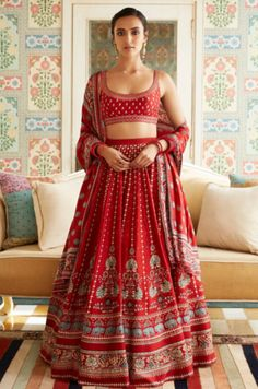 The vivid red Neysa Lehenga is graced with playful floral and elephant motifs printed on it. Paired with a matching dupatta and choli with zari and sequins work, the lehenga is perfect for a dreamy day wedding. Style Tip: Wear the Lehenga with our J Indian Gowns Dresses, Indian Fashion Dresses, Dress Indian Style, Indian Designer Outfits, Red Lehenga, Indian Lehenga, Lehenga Choli, Anarkali, Lehenga Skirt