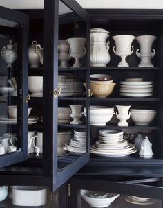 This is my next look coming into the cottage! A wonderful black primitive cupboard, filled with cream colored pottery.