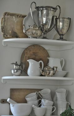 vintage metal, white ceramics and old bread boards - - - so warm!