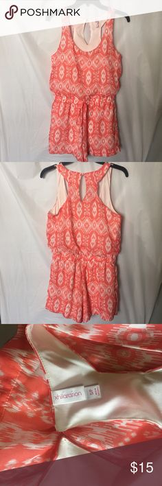 NWOT Cute romper I have an adorable xhilaration romper! It's NWOT, size S, coral and white print with elastic wait band and tie at the front, it feels very soft and light. Make me an offer! Xhilaration Pants Jumpsuits & Rompers