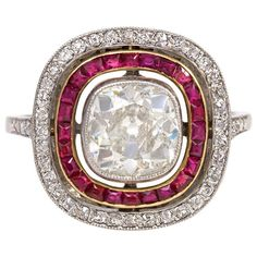 French Art Deco Ruby Diamond Ring. An Art Deco ring comprised of two concentric rows of rubies and diamonds surrounding an old cushion cut diamond of approx. 1.46 ct., in platinum and 18k gold. France.