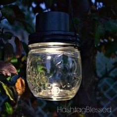 Combine $1 solar lights and small glass jars to create tiny, eco-friendly lanterns, great for lining your walkway or porch railing
