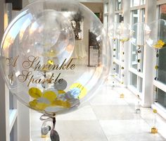 Sparkly message printed on balloon with gold and silver foil confetti
