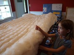 DIY all wool mattress - for futons or as a topper. Wool is cooler to sleep on than foam/latex and more earth-friendly!
