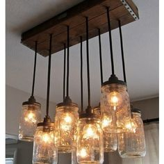 Mason Jar ceiling fixture.   These have become the next big thing. What's really great about this piece is the dark rustic wood canopy with metal detailing, makes all the difference to a now unique piece.