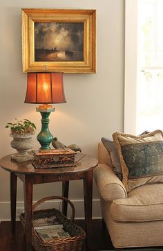 L.O.V.E. this side table!! And the cozy basket below filled with Southern Living Magazines! ;)
