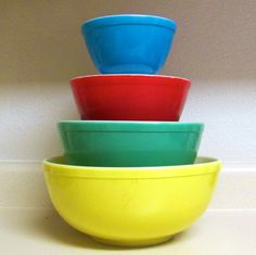 50's pyrex bowls. I have the yellow and green bowls. Anyone know where i could get the red and blue ones?