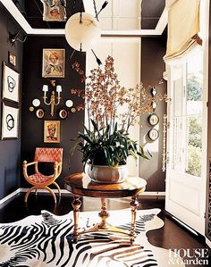 In the vestibule of a California home by Kelly Wearstler, the black wall paint was matched to the stripes of the zebra rug. In the vestibule of a California home by Kelly Wearstler, the black wall paint was matched to the stripes of the zebra rug. Interior Desing, Interior Inspiration, Interior And Exterior, Furniture Inspiration, Design Inspiration, Interior Office, Black Painted Walls, Dark Walls, Brown Walls