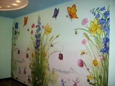 Adorable fairies, flowers, and butterflies mural custom painted in a child's room. #girlbedroommural #fairymural #butterflymural