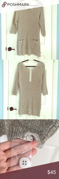 NWOT Free People Gray Knit Sweater Dress Tunic This is new without the tags (and the button in a plastic bag is still attached). This is a medium Free People sweater dress/ tunic. It is gray with some white in it. It has 3/4 length sleeves. There are two pockets on the bottom in the front with buttons. There are a line of bottoms in the back towards the neckline. Excellent condition! Let me know if you have any questions! Free People Sweaters