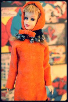 Twist n' Turn Francie is wearing Orange Cozy