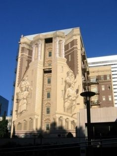 Eight story high trompe l'oeil of Lewis & Clark on theOregon History Center in Portland..Richard Haas