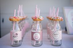 Donut-Themed Birthday Party - love the milk glasses topped with a donut! #kidsparty #partyidea