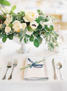 silver compote vase for white cream and green centrepieces at Unplugged Nautical Lake Michigan Wedding