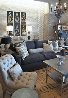 deep grey and linen-colored texture-heavy living room. Lots of elements, tile, concrete, wallpaper, rattan rug, iron chandelier. Really like this a lot.