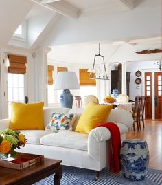This room is Triadic. The touches of the primary colors red, yellow, and blue create an interesting space and a cheerful room.